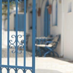 Blue Owatrol Deco applied to a metal gate