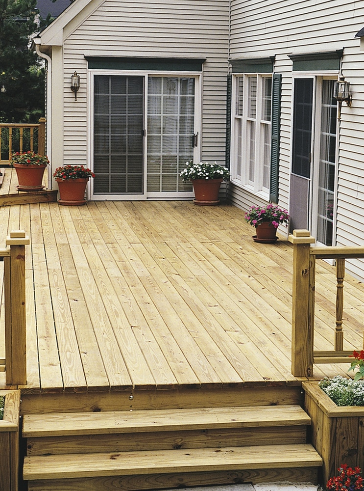 new wood deck treated with Seasonite