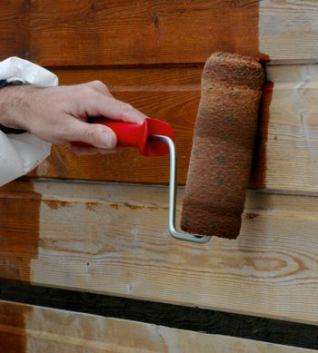 Textrol being applied to a garden shed