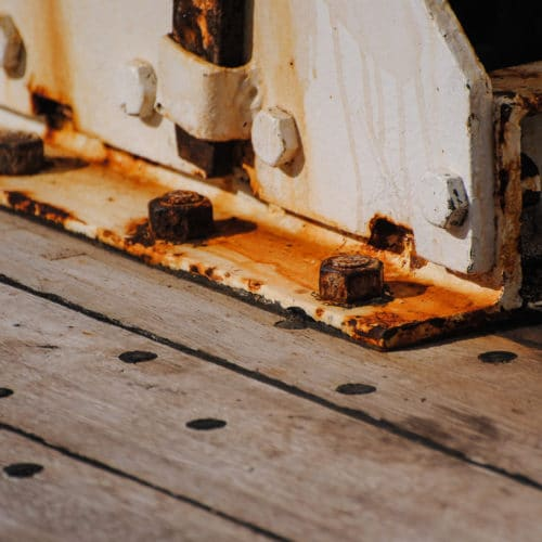 Rusted nut and bolt on stair well