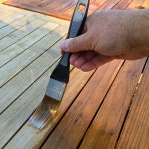 Deks Olje D1 being applied to a garden table