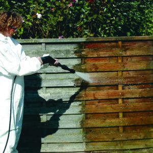 Pressure washing Net-Trol off a fence