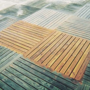 Before and after using Net-Trol on decking