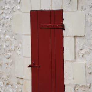 AP60 in red applied to wooden door