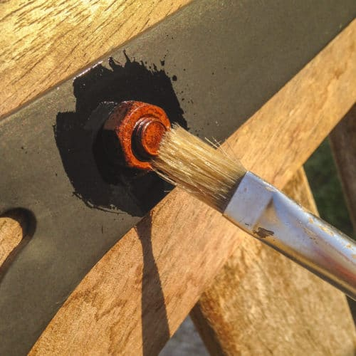 Owatrol Oil being applied to rusted nut with a brush