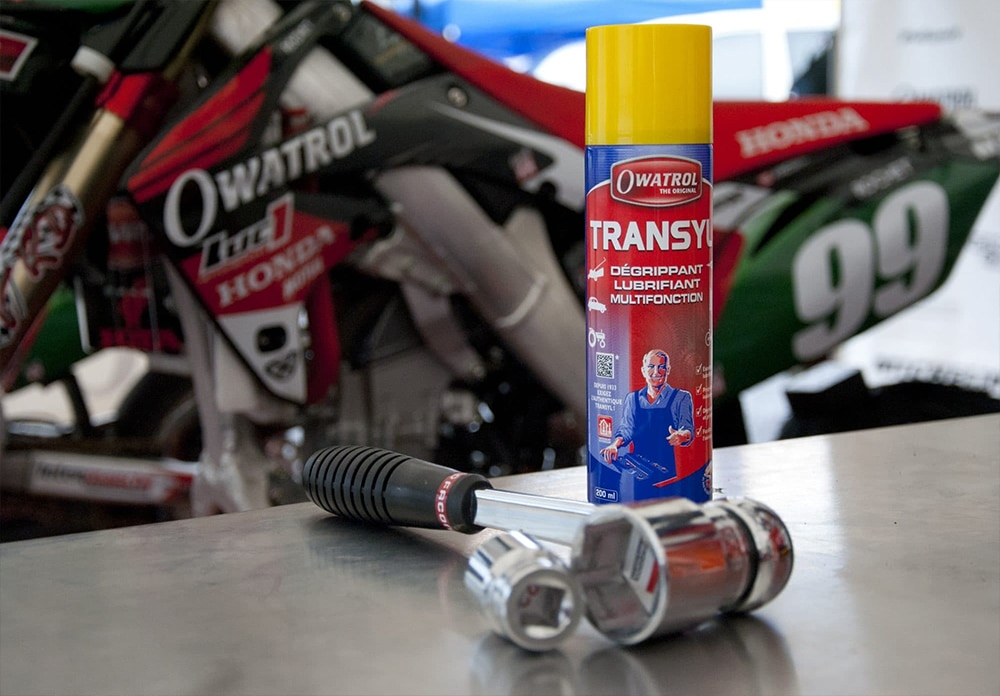 Transyl and socket wrench in front of a motor bike