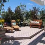 Garden deck with furniture and plants