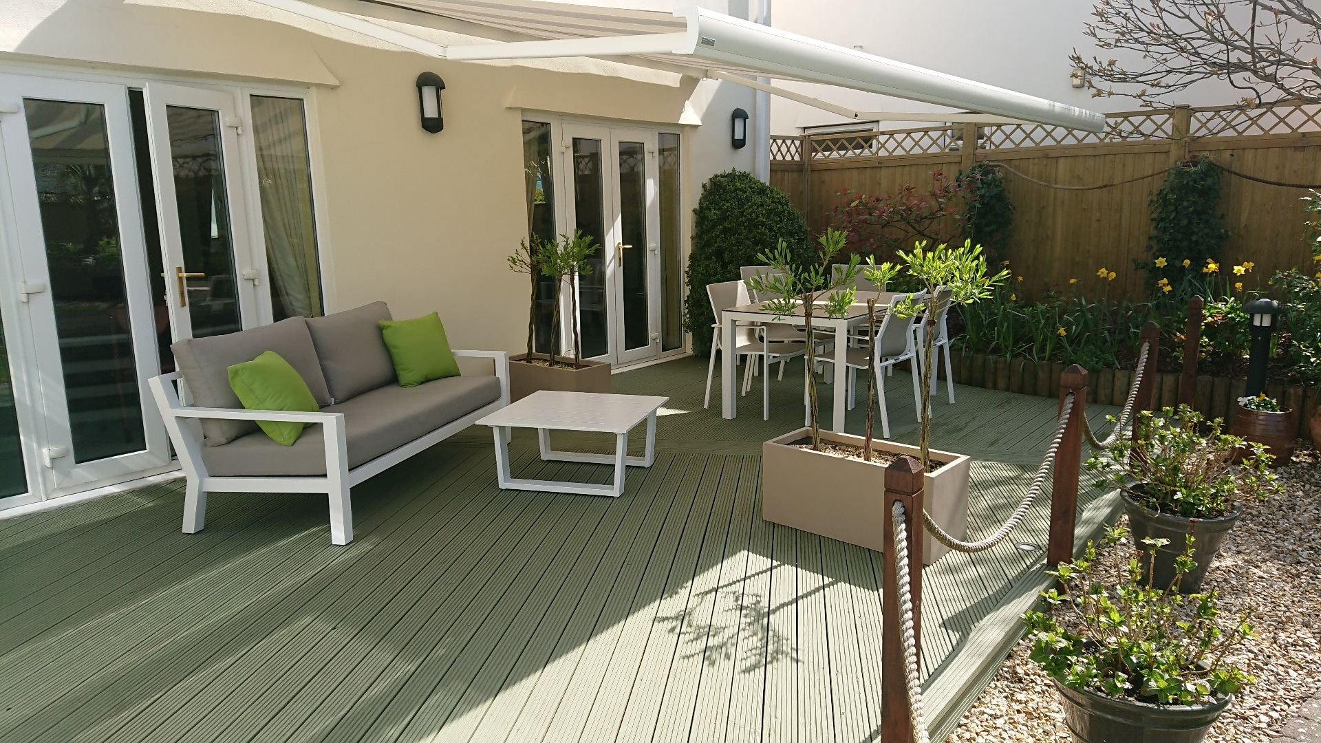 Garden deck with green paint finish